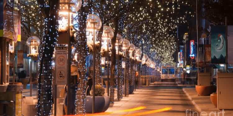photo taken down the 16th Street Mall length in the evening and all of the trees are decorated with white and blue lights for the holidays.