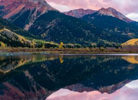 reflection of colorful mountain peaks in a lake in the foreground