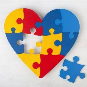 autism heart with single puzzle piece removed